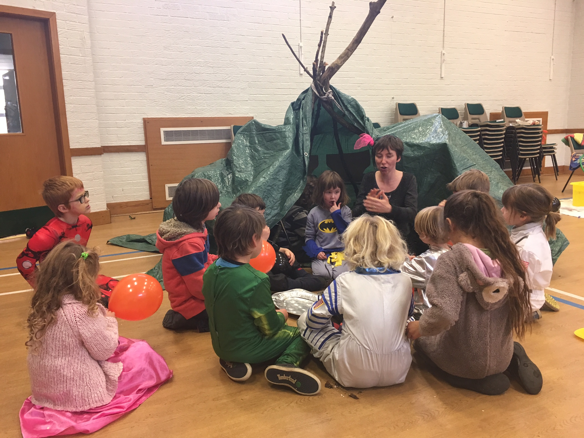 Indoor party with den and tarps and story teller